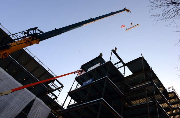Photo by Christian Abraham, Connecticut Post The final steel beam for the new $75 million, 372,000 square foot Jewish Senior Services is raised by crane into place at the new site on Park Avenue in Bridgeport, Conn. on Thursday Jan. 24, 2015.