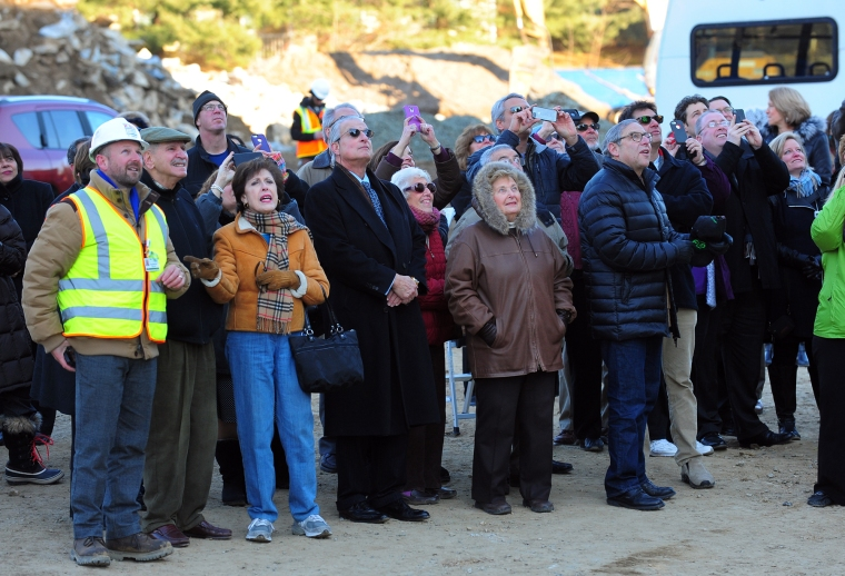 The final steel beam for the new $75 million, 372,000 square foot Jewish Senior Services is put into place at the new site on Park Avenue in Bridgeport, Conn. on Thursday Jan. 24, 2015. Photo by Christian Abraham, Connecticut Post