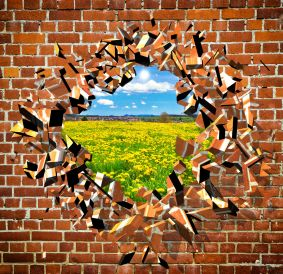 33216490 - broken brick wall with beautiful landscape behind