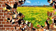 33216490 - broken brick wall with beautiful landscape behind